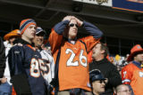 267 Broncos fans Zach Hansen, cq, left, and his brother Josh Hansen, cq, show dejection after a...