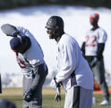 Linebacker Keith Burns laughs while stretching during practice for their upcoming AFC Championship...