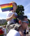 (DENVER, CO., June 27, 2004)  Joey Johnson takes gets a high view of the 18th annual PrideFest...