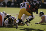 388 Broncos #38 Mike Anderson struggles to gain yards against Steelers #28 Chris Hope at Invesco...
