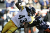 524 Steelers #43 Troy Polamalu tries to grab the ball along with Broncos #38 Mike Anderson during...
