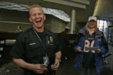 KOA surprised Denver police officer John Bishop (cq) with Bronco tickets.  He was working off-duty...
