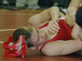 Lafayette, CO Jan. 20, 2006 Jacob Milewski of Denver East loses his head gear as he trys to avoid...