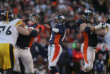 775 Denver's #16 Jake Plummer throws a 30 yard TD pass to #85 Ashley Lelie in the third quarter at...