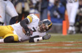 831 Steelers quarterback #7 Ben Roethlisberger lands in the endzone for a touchdown in the fourth...
