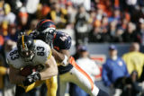 910 Pittsburgh Steelers tight end Heath Miller is taken down by Denver's Sam Brandon during the...
