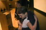 **1/23/06** Brandon Silveria hugs a student from JFK High School after giving a school wide...