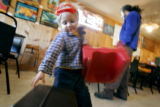 Two and a half year-old Isaiah Moonlight (cq) of Valdez, N.M. plays at the Taos Diner as his dad,...