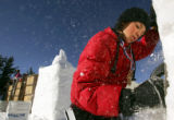 Max Falls (cq), 10, a fifth-grade student at Breckenridge Elementary, works on a snow sculpture in...