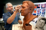 (Pleasant Grove, Utah , Shot 6/21/2004)  Sculptor Blair Buswell puts some of the finishing touches...