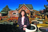 Local developer Carolyn Kruse (cq) poses in front of a house at 207 Perry St. in Castle Rock...