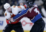Calgary Flames player Marcus Nilson, left, mixes it up with Colorado Avalanche player Karlis...