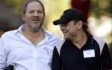IDET105 - Harvey Weinstein, left, co-founder of Miramax, walks with Michael Ovitz, film producer,...