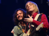 Pearl Jam lead singer Eddie Vedder(cq), left and Tom Petty(cq), lead singer of Tom Petty and the...