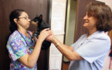 L to R: Veterinary Technician Monica Zaragoza (cq) and Dr. Jeannette Barnes (cq) Veterinarian at ...