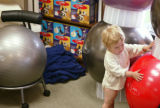 KAS033 Lucien Juilland King, 16 months, checks out the FitBALLs while his mother shops at the...