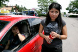Migdy Jimenez, cq, left, sits in her car as Endora Ayala, cq, International student from Mexico,...