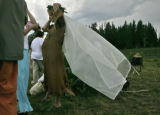 Leah Metzger (cq), 28, middle, of Buffalo, NY., adjusts her veil moments before her traditional...