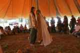 Casey Brown (cq), 23, of Venture, Calif., left, and new bride Leah Metzger (cq), 28, right, of...