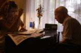 (BRUSH, Colo., June 9, 2004) Carrie Gray reads to granddad, Harold. Twice a week while her dad,...