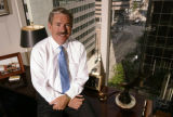 KAS036 Douglas Jones in his office at Jones Realty Group on Monday, July 10, 2006. (KEITH...