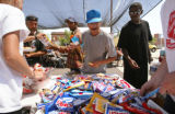KAS039 Picnickers get chips and candy from Salvation Army volunteers during a community picnic for...