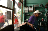(DENVER, Colo., June 14, 2004) Leonard Dixon, of Joe's Shoe repair spends a quiet afternoon at his...