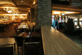 A view of the in-house restaurant, seen at left,is separated from the gaming floor at the...