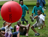 Children from Hallet Elementary School and Whittier Elementary School play crab-soccer Wednesday...