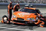 NHTT104 - Tony Stewart's crew checks the damage on his car in the pits during the NASCAR Nextel...