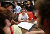 KAS101 Cast members discuss the script for Skills Like This with director Monty Miranda, in hat,...