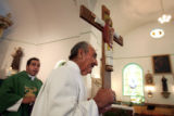 Father Benito Hernandez, cq, left, vicar of Our Lady of Guadalupe Parish Church, Colorado's...