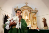 Father Benito Hernandez, cq, vicar of Our Lady of Guadalupe Parish Church, Colorado's oldest, in...