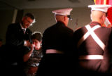 Sam and Mary Holder, cq, Littleton, pause as the colors are retired after a ceremony on April 30,...