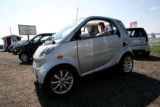 ST Tripathi, cq, of Elizabeth RV and Automotive Center sits in a SMART car. The SMART car get 60...