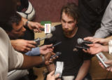 (Denver, Colo., May 4, 2004) Peter Forsberg talks with the media after the Colorado Avalanche were...
