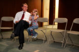 Denver Public Schools superintendent Michael Bennet, with his daughter Caroline, cq, 6,  speaks to...