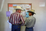 Steve Watkins, cq, left, talks with rancher Raymond Jones, cq, La Junta, before an auction at...