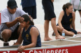 Team British Columbia coach Wayne Charlie(cq) cools off Cecelia Pelkey, 16, after her 3,000 meter...