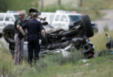 Officers with the Jefferson County Sheriffs Department and the Colorado State patrol surveys the...