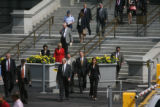 Governor Bill Owens crosses the street from the capitol with members of his cabinet and other...