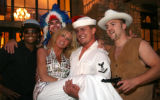 (Denver, Colo., June 24, 2006) Janet Elway with characters from Talent West portraying the Village...
