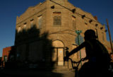 Billy Vigil, 10, of Trinidad, rides his bike in front of the old Aguilar State Bank building in...