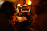 Benny Cruz, 55, left, and Jim Tokar, 60, catch up over a few beers at the Sunset Tavern in...