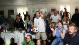 Manuel Sauvage(cq) (center), of Denver, reacts along with other France supporters as their team...