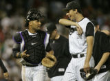 Colorado Rockies catcher Yorvit Torrealba, left, and LHP Jeff Francis, right, leave the field all...