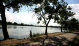 Sam Castillo (cq) does some fishing at Berkeley Lake Monday afternoon July 10, 2006 in Denver. ...