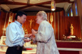 (DENVER, Colo., May 5, 2004) Chaplains Tuan Le (cq). left, and Ann Christenson (cq), right, anoint...