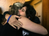 Joanne Cowan(cq), right, of Boulder, hugs defendant Janet Roberts(cq), of Boulder County, on the...
