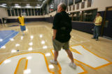 The Denver Nuggets head coach George Karl, center, stoped by the practice court to ask new guard...